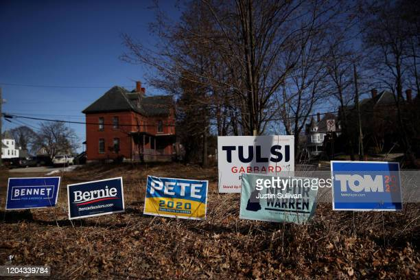 Yard signs for Democratic presidential candidates are posted in front of a home on February 05 2020 in Manchester New Hampshire The New Hampshire...