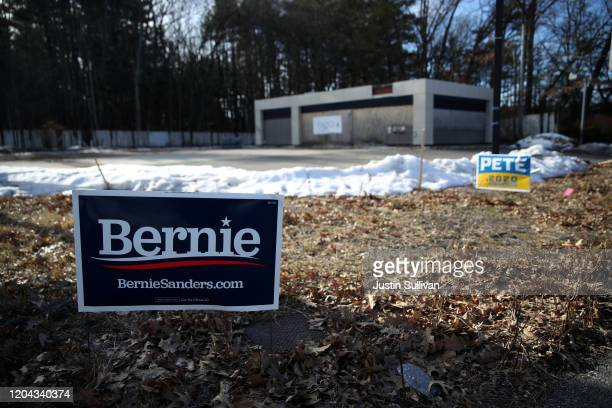 Yard signs for Democratic presidential candidates Sen. Bernie Sanders and former South Bend, Indiana Mayor Pete Buttigieg are posted in front of an...