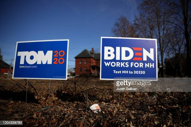 Yard signs for Democratic presidential candidates Tom Steyer and former Vice President Joe Biden are posted in front of a home on February 05 2020 in...