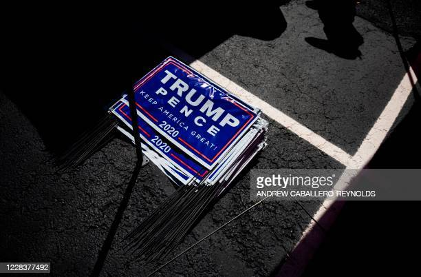 Yard signs for US President Donald Trump are seen during a Republican voter registration in Brownsville Pennsylvania on September 5 2020 Less than...