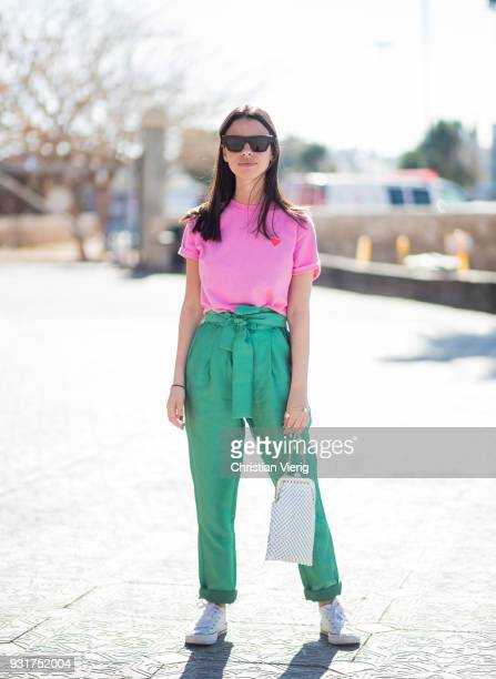 Yarden Cohen wearing pink shirt green pants bag Converse shoes is seen during Tel Aviv Fashion Week on March 13 2018 in Tel Aviv Israel