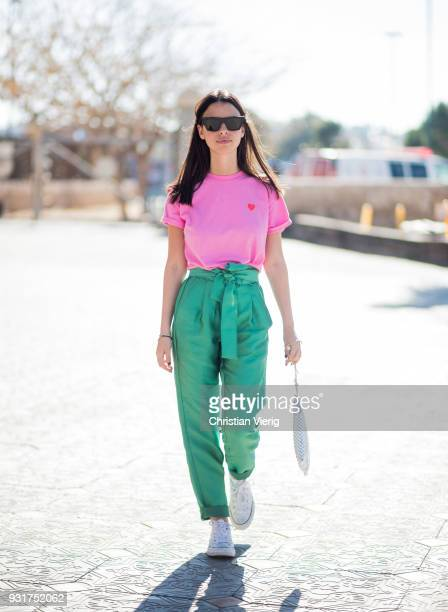 Yarden Cohen wearing pink shirt green pants bag Converse shoes is seen during Tel Aviv Fashion Week on March 13 2018 in Tel Aviv Israel