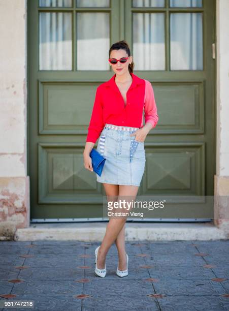 Yarden Harel wearing denim skirt red blouse white pumps clutch is seen during Tel Aviv Fashion Week on March 13 2018 in Tel Aviv Israel