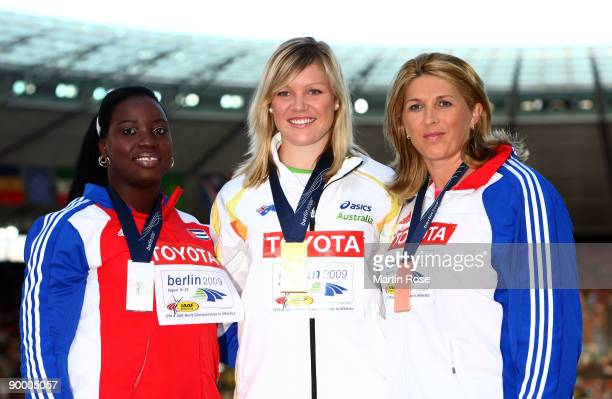 Yarelis Barrios of Cuba receives the silver medal Dani Samuels of Australia the gold medal and Nicoleta Grasu of Romania the bronze medal during the...
