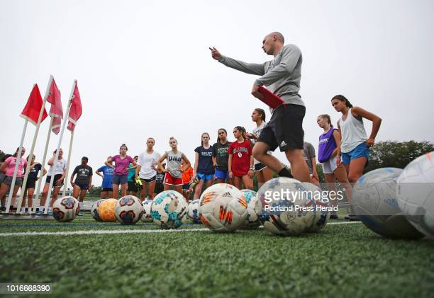 Yarmouth girls soccer coach Chris Coleman speaks to his team at the end of opening day of practice The Yarmouth High School defending Class B girls'...