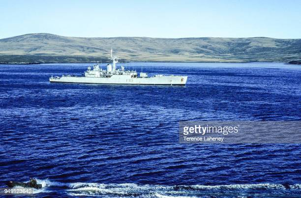HMS Yarmouth with a Commando Rigid Raider boat in foreground in San Carlos Water known as 'Bomb Alley' in the Falkland Islands during the Falklands...
