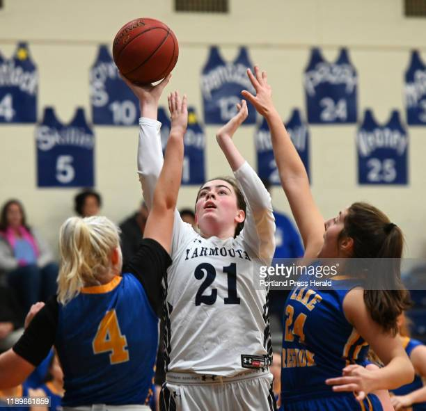 Yarmouth's Margaret McNeil shoots over Lake Region defenders ShelbyLynne Sheldrick left and Elle Hall Saturday Dec 14 2019