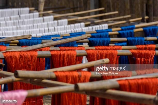 Yarn being dried under sunlight atat poor textile village, nearby U Bein bridge, Mandalay, Myanmar