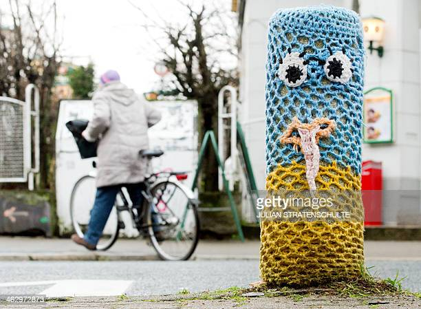 A yarn bombing streetart piece is pictured on January 15 2014 in Hannover Germany AFP PHOTO / DPA /JULIAN STRATENSCHULTE /GERMANY OUT