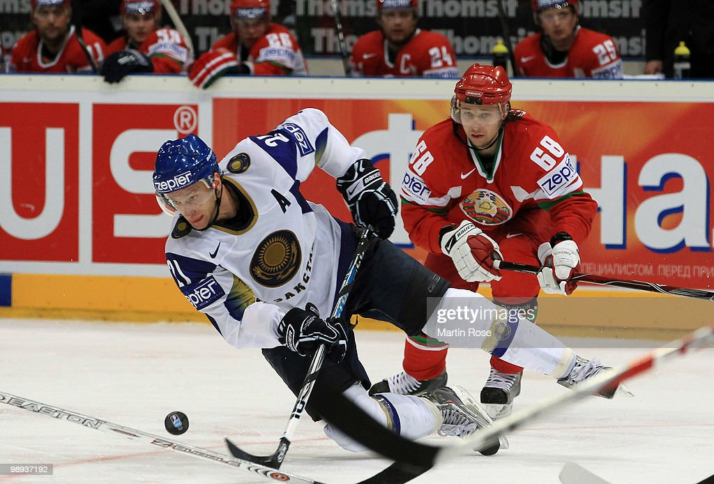 Yaroslav Chupris (R) of Belarus and Dmitri Dudarev (L) of Kazakhstan battle for the puck during the IIHF World Championship group A match between Slovakia and Russia at Lanxess Arena on May 9, 2010 in Cologne, Germany.
