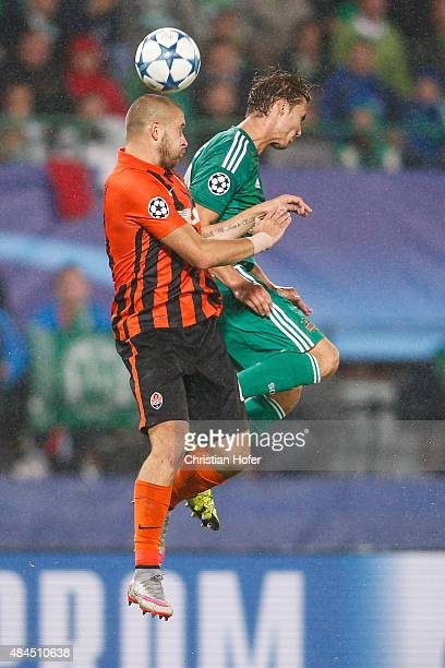 Yaroslav Rakitskiy of Donetsk competes for the ball in the air with Mario Pavelic of Vienna during the UEFA Champions League Qualifying Round Play...