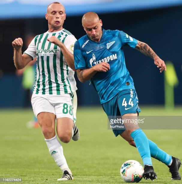 Yaroslav Rakitskyy of FC Zenit Saint Petersburg and Denis Glushakov of FC Akhmat Grozny vie for the ball during the Russian Premier League match...