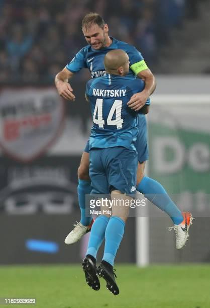 Yaroslav Rakits'kyy of Zenit St Petersburg celebrates with teammate Branislav Ivanovic after scoring his team's first goal during the UEFA Champions...
