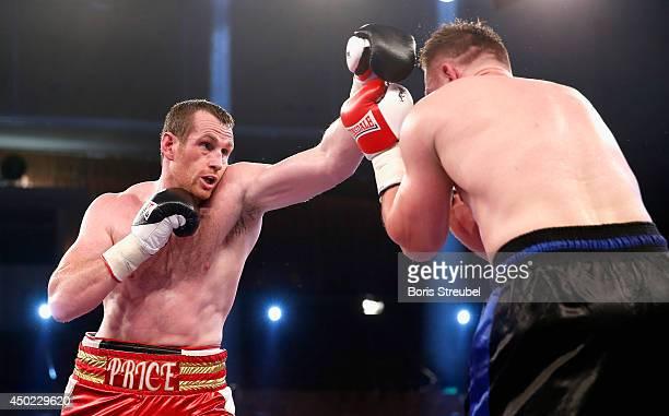 Yaroslav Zavorotnyi of Ukraine and David Price of Great Britain exchange punches during their heavyweight fight at Sport und Kongresshalle on June 7...