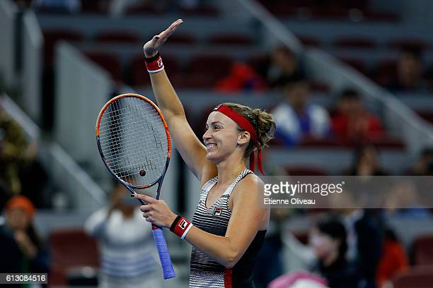 Yaroslava Shvedova of Kazakhstan celebrates her victory over Alize Cornet of France during the Women's singles third round match on day seven of the...