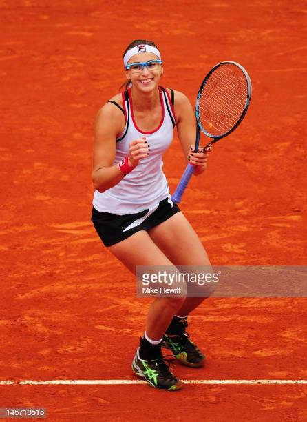 Yaroslava Shvedova of Kazakhstan celebrates victory in her women's singles fourth round match against Na Li of China during day 9 of the French Open...