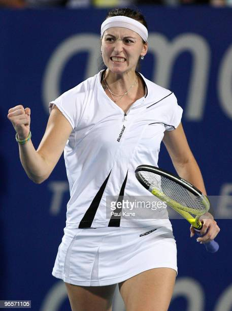 Yaroslava Shvedova of Kazakhstan celebrates winning her match against Laura Robson of Great Britain in the Group B match between Great Britain and...