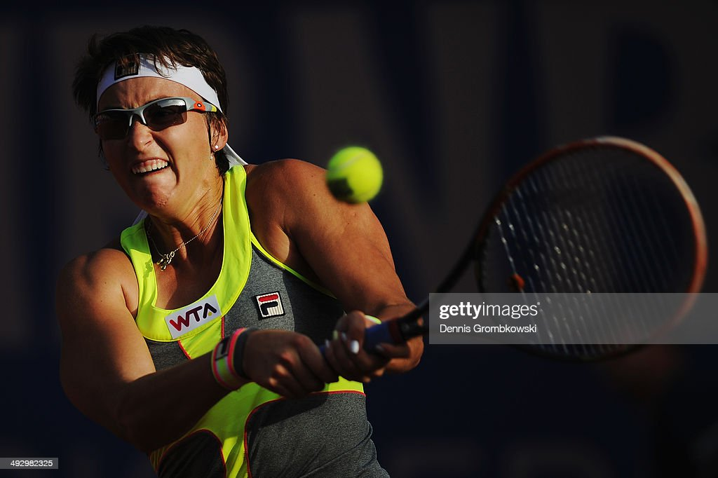 Yaroslava Shvedova of Kazakhstan plays a backhand during her match against Eugenie Bouchard of Canada during Day 6 of the Nuernberger Versicherungscup on May 22, 2014 in Nuremberg, Germany.