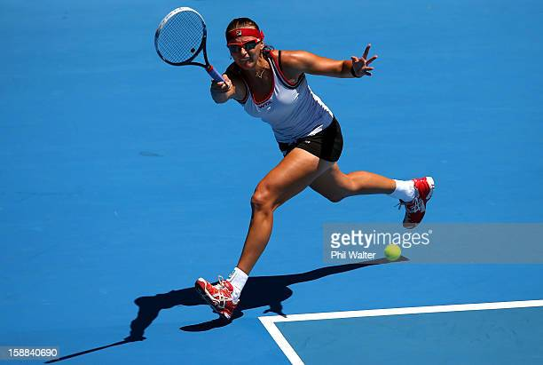 Yaroslava Shvedova of Kazakhstan plays a forehand in her first round match against Lara Arruabarrena-Vecino of Spain during day two of the 2013 ASB...