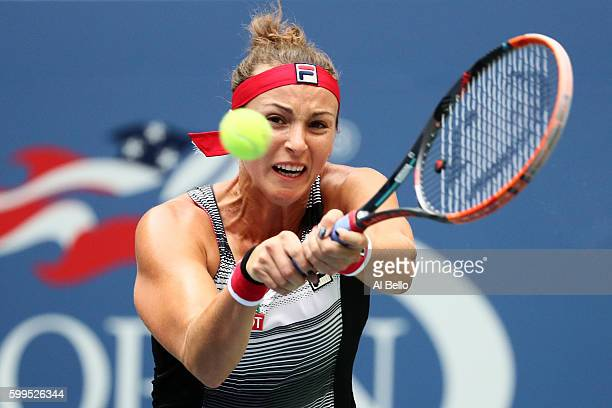 Yaroslava Shvedova of Kazakhstan returns a shot to Serena Williams of the United States during her fourth round Women's Singles match on Day Eight of...