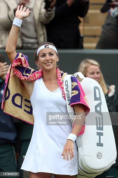 Yaroslava Shvedova of Kazakhstan shows her appreciation for the crowd after her Ladies' singles fourth round match against Serena Williams of USA on...