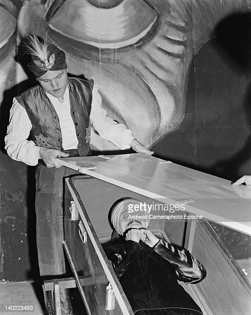 Yarto Yowa the fakir is enclosed in a coffin by his assistant during a performance in Rome circa 1950