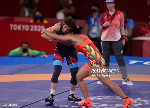 Yasemin Adar of Turkey and Aline Silva of Brazil compete during their Women's Freestyle 76 kg in the Tokyo 2020 Olympic Games at Makuhari Messe Hall...