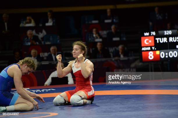 Yasemin Adar of Turkey celebrates after winning against Ekaterina Bukina of Russia in the women's 76 kg category within the 2018 European Wrestling...