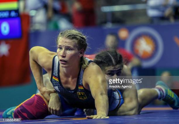 Yasemin Adar of Turkey competes with Aline Rotter Focken of Germany in women's freestyle 76 kilograms match on the 4th day of the 47th International...