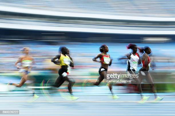 Yasemin Can of Turkey and Hellen Onsando Obiri of Kenya lead the pack during the Women's 5000m Round 1 Heat 1 on Day 11 of the Rio 2016 Olympic Games...