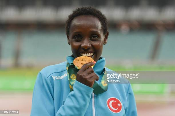 Yasemin Can of Turkey with her Gold medal, during a medal ceremony of Women's 10000m, on day five of Athletics at Baku 2017 - 4th Islamic Solidarity...