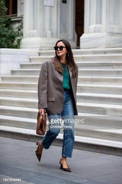 Yasemin Ögün is seen wearing Acne blazer, denim jeans Celine, brown Bottega Veneta bag, Versace shoes, green Isabel Marant jumper on October 19,...