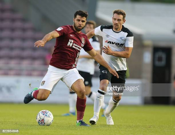 Yaser Kasim of Northampton Town controls the ball watched by Craig Bryson of Derby County during the PreSeason Friendly match between Northampton...