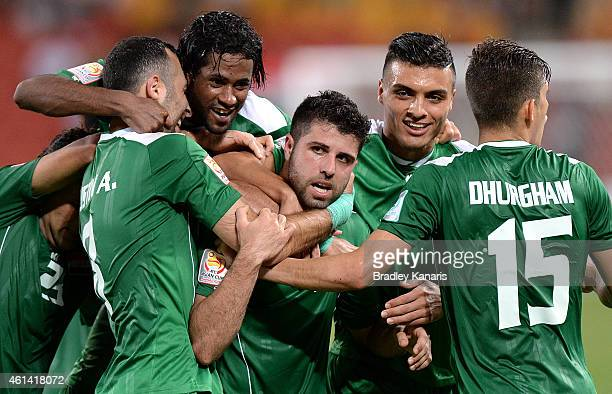Yaser Safa Kasim of Iraq celebrates with team mates after scoring a goal during the 2015 Asian Cup match between Jordan and Iraq at Suncorp Stadium...
