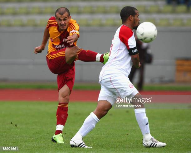 Yaser Yildiz of Galatasaray shoots the ball and Louissi Hicham of Casablanca blocks the shot during the Zayon Cup match between Galatasaray Istanbuch...