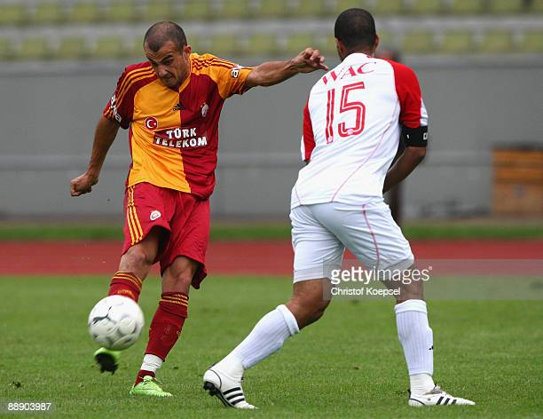 Yaser Yildiz of Galatasaray shoots the ball and Louissi Hicham of Casablanca blocks the shot during the Zayon Cup match between Galatasaray Istanbul...