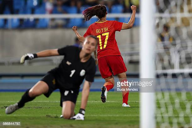 Yasha Gu of China celebrates after scoring China's first goal past Roxanne Barker of South Africa during the Women's Group E first round match...