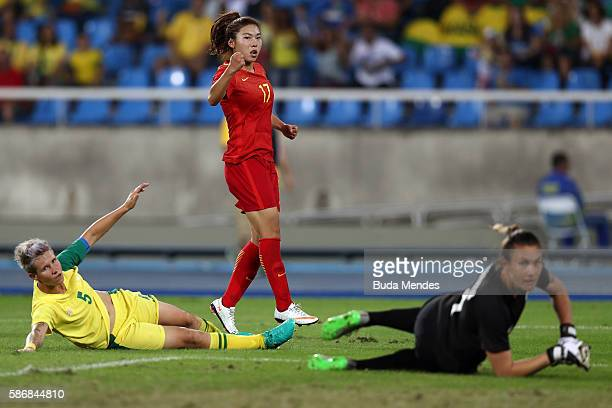 Yasha Gu of China celebrates after scoring China's first goal past Roxanne Barker and Janine van Wyk of South Africa during the Women's Group E first...