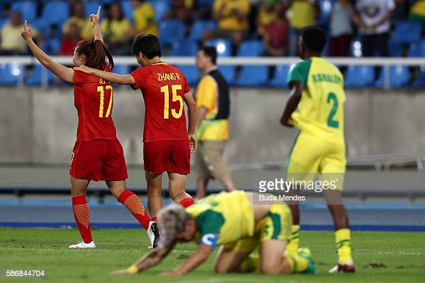 Yasha Gu of China celebrates with teammate Rui Zhang after scoring China's first goal during the Women's Group E first round match between South...