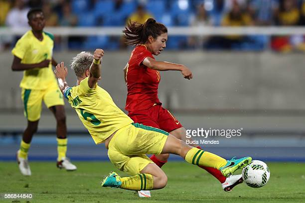 Yasha Gu of China scores China's first goal past Janine van Wyk of South Africa during the Women's Group E first round match between South Africa and...