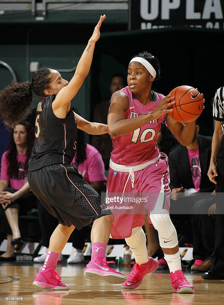 Yashira Delgado #5 of the Florida State Seminoles defends against Michelle Woods #10 of the Miami Hurricanes on February 10, 2013 at the BankUnited Center in Coral Gables, Florida. The Seminoles defeated the Hurricanes 93-78.
