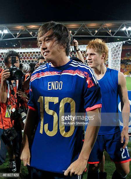 Yashuhito Endo of Japan celebrates his 150th game for Japan after the 2015 Asian Cup Group D match between Iraq and Japan at Suncorp Stadium on...