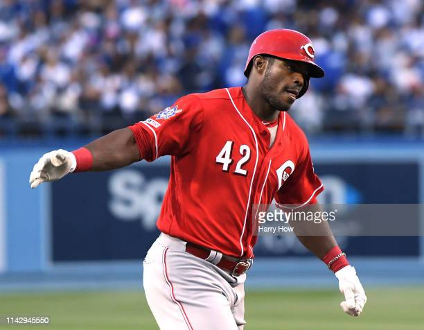 Yasiel Puig of the Cincinnati Reds celebrates his two run homerun to take a 20 lead during the first inning against the Los Angeles Dodgers on Jackie...