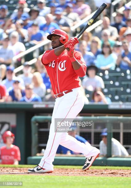 Yasiel Puig of the Cincinnati Reds follows through on a swing during the first inning of a spring training game against the Chicago Cubs at Goodyear...