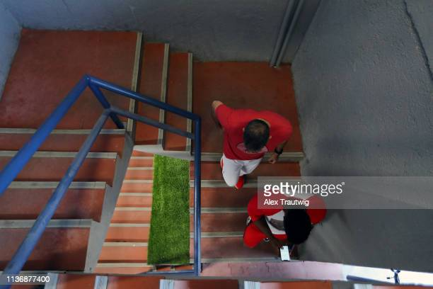Yasiel Puig of the Cincinnati Reds heads to the field to take batting practice prior to the game between the St Louis Cardinals and the Cincinnati...