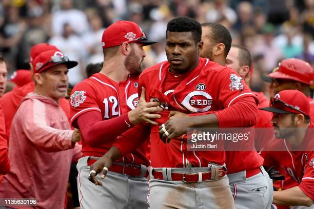Yasiel Puig of the Cincinnati Reds is restrained by Matt Kemp after benches clear in the fourth inning during the game against the Pittsburgh Pirates...