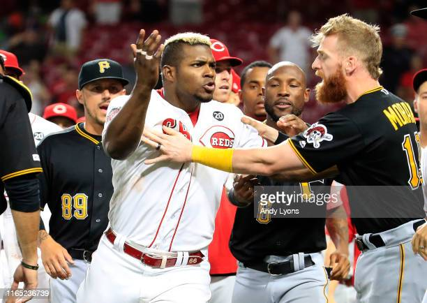 Yasiel Puig of the Cincinnati Reds is restrained during a bench clearing altercation in the 9th inning of the game against the Pittsburgh Pirates at...
