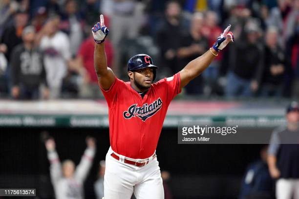 Yasiel Puig of the Cleveland Indians celebrates after hitting a walk-off RBI single to deep right during the tenth inning against the Detroit Tigers...