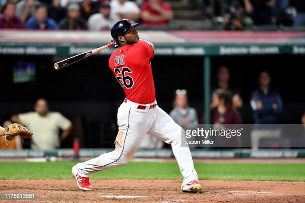 Yasiel Puig of the Cleveland Indians hits a walkoff RBI single to deep right during the tenth inning against the Detroit Tigers at Progressive Field...