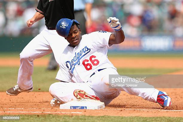 Yasiel Puig of the Dodgers is tagged out sliding back to first base during the MLB match between the Los Angeles Dodgers and the Arizona Diamondbacks...